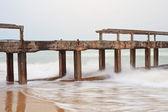 Sea and a destructed bridge — Foto Stock