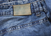 Lather label and blue jeans — Stock Photo