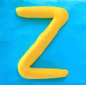 Yellow clay alphabet letter Z — Stock Photo