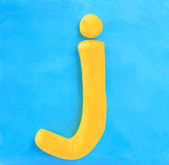 Yellow clay alphabet letter J — Foto Stock