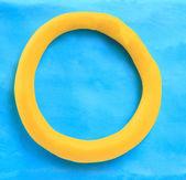 Yellow clay alphabet letter O — Stok fotoğraf