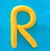 Yellow clay alphabet letter R — Стоковое фото