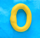 Yellow clay alphabet letter O — Stock Photo