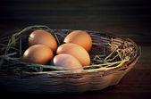 Fresh eggs on rice straw — Stock Photo