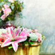 Lily flower bouquet and roses decorated by arrangement in wood bucket vertical form use as  home decoration nature flora theme — Stock Photo