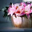 Lily flower in wood bucket with cookie light decorated in home living room — Stock Photo