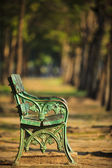 Old green bench in park with blurry background use as copy space — Stock Photo