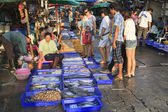 People at the fish market — Stock Photo