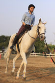 BANGKOK THAILAND: February 27: unidentified young woman practices to ride a horse in horse riding field on Feb 27, 2013 in Bangkok, Thailand — Stock Photo