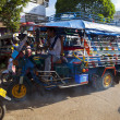 Champasak Laos - Nov23- three wheel vehicle  in Doawreung market — Stock Photo