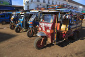 Champasak Laos - Nov23- group of three wheel vehicle queue in D — Stock Photo