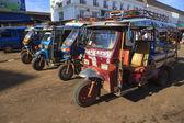 Champasak Laos - Nov23- group of three wheel vehicle queue in D — Stock Photo