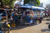Champasak Laos - Nov23- three wheel vehicle in Doawreung market — Stock Photo