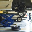 Car wheel suspension and brake system maintenance in auto serv — Stock Photo #37440301