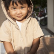 Young children wearing hood sweat with lovely face standing at h — Stock Photo