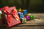 Red gift box on old wood floor for multipurpose gift festival — Stock Photo