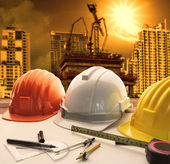 Safety helmet on architect ,engineer working table with modern b — Stock Photo