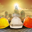 Stock Photo: Safety helmet and building construction sketching on paper work use for construction industry business and architecture engineering topic