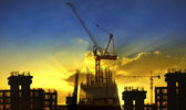 Building and crane construction site against beautiful dramatic — Stock Photo