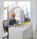 Architect engineer working in office room against building const — Stock Photo