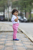 Asian kid children standing beside street road with relaxing emo — Stockfoto