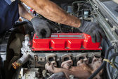 Hand repair and maintenance cylinder diesel engine of light pick — Stock Photo