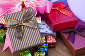 Stack of gift box lying on top wood table use for gift festival  — Stock Photo