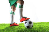Legs of football player ,soccer player and soccer ball isolated  — Stock Photo