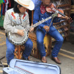 BANGKOK THAILAND - FEB22 :western musician playing banjo guitar — Stock Photo #41746081