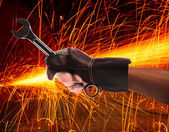 Hand of worker man working by leather hand glove protection heat of splashing fire in heavy industry factory use for metal and iron industrial manufacturing theme — Stock Photo