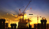 Big crane and building construction against beautiful dusky sky — Stock Photo