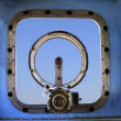 Old military war ship window against blue sky background use for — Stock Photo