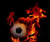 Soccer football and fire flaming — Stock Photo