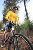 Young man riding mountain bike mtb in jungle track use for sport — Stock Photo