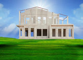 Frame knock down of house construction on beautiful green grass field use for real estate and land development business — Stock Photo