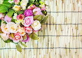 Close up of beautiful artificial multicolor roses flowers bouque — Stock Photo