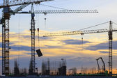 Crane of building construction against beautiful dusky sky — Stock Photo