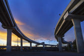 Concrete structure of express way against beautiful dusky sky us — Stock Photo