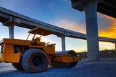 Bulldozer tank road construction machine against dusky sky and i — Stock Photo