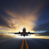 Passenger plane take off from runways against beautiful dusky sk — Stock Photo