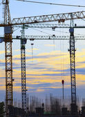 Crane of building construction against beautiful dusky sky use f — Stock Photo