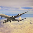 Passenger jet plane flying over cloud — Stock Photo #47099505