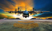 Military plane landing on airforce runways against beautiful dus — Stock Photo