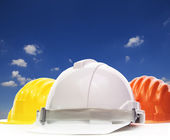 Three of safety helmet construction protection on white against — Stock Photo