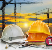 Civil engineer working table with safety helmet and writing inst — Stock Photo