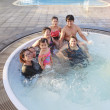 Big family people  and brothers relaxing in water pool with happ — Stock Photo #47875975