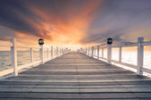 Old wood bridg pier with nobody against beautiful dusky sky use  — Stock Photo