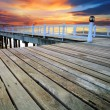 Wood piers and pavillion sea scene with dusky sky use for natura — Stock Photo #48219789