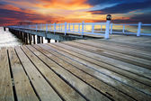 Wood piers and pavillion sea scene with dusky sky use for natura — Stock Photo