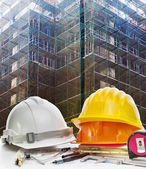 Safety helmet and engineering working tool against building cons — Stock Photo